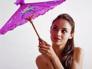 Fedra toying her pussy with a purple parasol