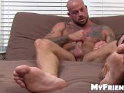 Inked hunk Sean Duran jacks off while his feet are licked