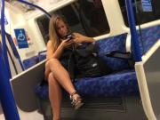 Tanned British Woman showing Legs on Tube