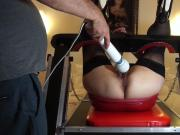 Sosso de b on her red torture chair!