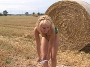 Amateur country girl dildo fucking by the haystack