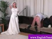 Transvestite bride sits on her grooms face
