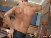 Guy in jeans jerking off in the kitchen