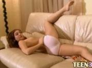 Teen pink with hairy vagina on the sofa