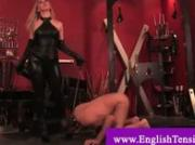 Humiliated slave gets his cock tied up