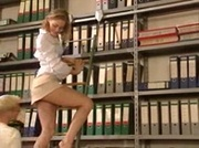 Blonde librarian in mini skirt