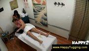 Bigbreasted asian masseuse jerks him off
