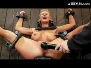 Busty Blonde With Nipple Clips Tied To Wall Getting Her Pussy Fingered Stimulated With Vibrator Whip