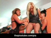 Three biker girls in stockings peeing and playing with a dil