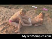 Sweet lesbian sluts kissing on the sand
