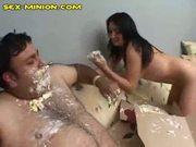 Naked babe feeds fat guy