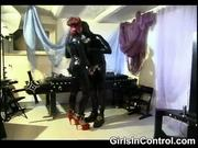 Mistress punishing her slave with hot wax