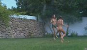 Three totally naked girls in a garden