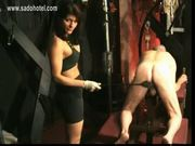 Beautiful mistress with big tits spanks dirty slave on his a