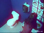 Horny teen masturbating in public toilet