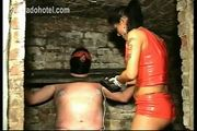 Masked slave tied up in a dungeon gets his nipples electrosh