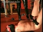 latex wearing mistress stands on and electrocutes cock of slave 127