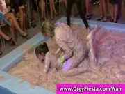 Fully clothed wam ladies having a wet and messy mud wrestling contest