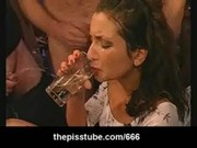 Euroepean brunette slut drinks pee from a glass with a straw