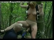 Blonde slut tied to a tree and abused