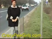 Crazy pee girl does it outdoor