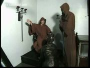 Dungeon full of horny masters ties scared slave to a wall an