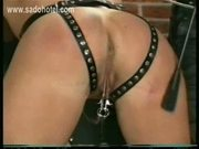 Slave got her pussy stretched with clamps with weight on it