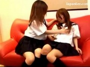 2 Schoolgirls In Uniform Kissing Rubbing Breasts On The Couch
