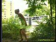 Crazy pee girl outdoor action