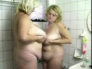 Mother and daughter in shower