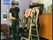 Milf slave in leather bending over a ladder is hit and spank