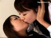 2 Schoolgirls In Uniform Kissing Passionately Patting On The Bed
