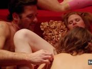 Couples get together inside the red room to engage in hot group sex