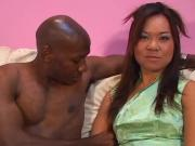 Naughty Asian honey gets large black cock up ti...