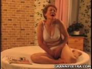 Naughty Grandma Strokes Her Boobs Pussy