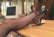 Female therapist in stockings has footsex with a patient with a foot fetish