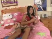 Asian Cat Rubs on Her Bed
