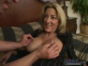 Lexi Carrington is a mature blonde with big fake tits