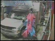 Moron gets out of his car in a car wash