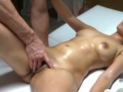 Masseur pours oil on sexy brunette babe