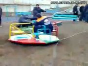 Russian roulette - Car pulls merry go round to insanely fast speed