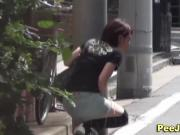 Asian girl pees in public street