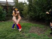 Slender teens playing around in the backyard for money