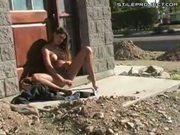 hot teen dildos herself next to busy street