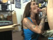 Watch this tattooed girl as she sucks on the pawnman's fat dick