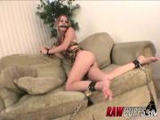 Young girl shackled and chain in sheer G string