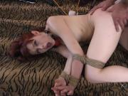 Gagged redhead in rope bondage gets anal