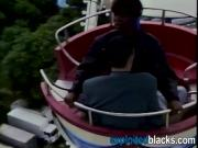 Ebony slut sucking big white cock and gets fucked in the amusement park