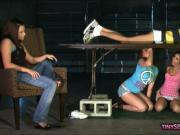 Three brunette women blowjob under the massage table