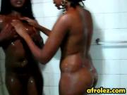 Busty Ebony lesbians having fun under the shower